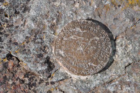 A rather battered geodetic survey marker. Now that would be a fun game to play on your phone: find geodetic survey markers!