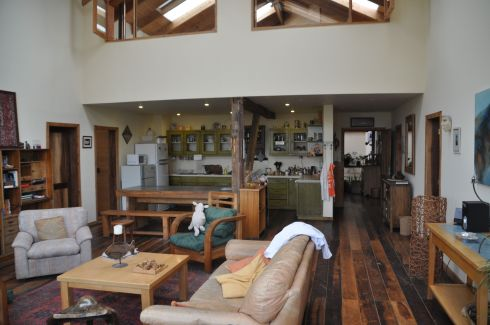 Looking through the common room to the kitchen. Guest rooms above, and on all sides of the common room.