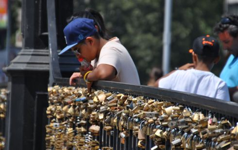 Bridge at the bottom of the hill covered in locks of love.