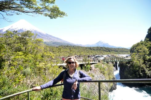 Me in front of volcanoes and waterfalls.