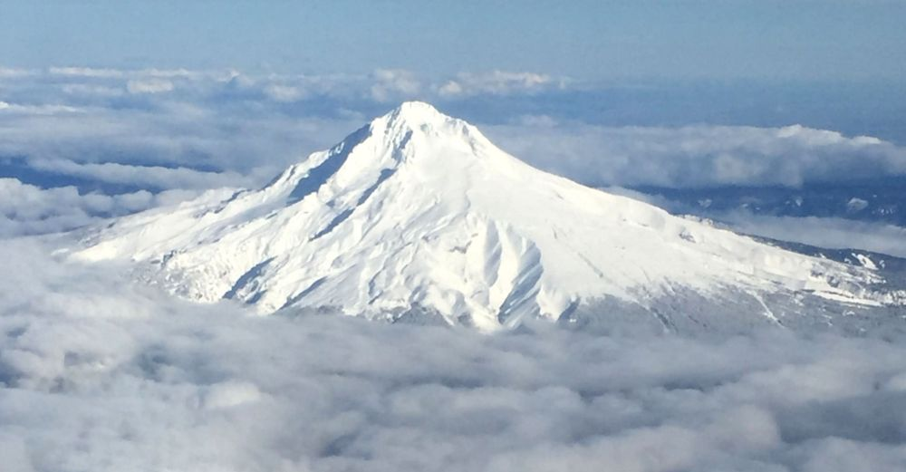 My favourite volcano of them all was back home in Oregon. Here, Mt. Hood rises from the clouds as we approach Portland.