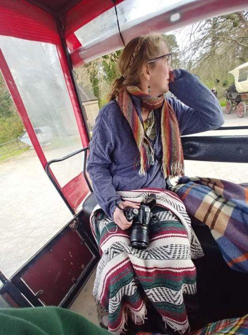 Me under blankets in the buggy behind Nancy.